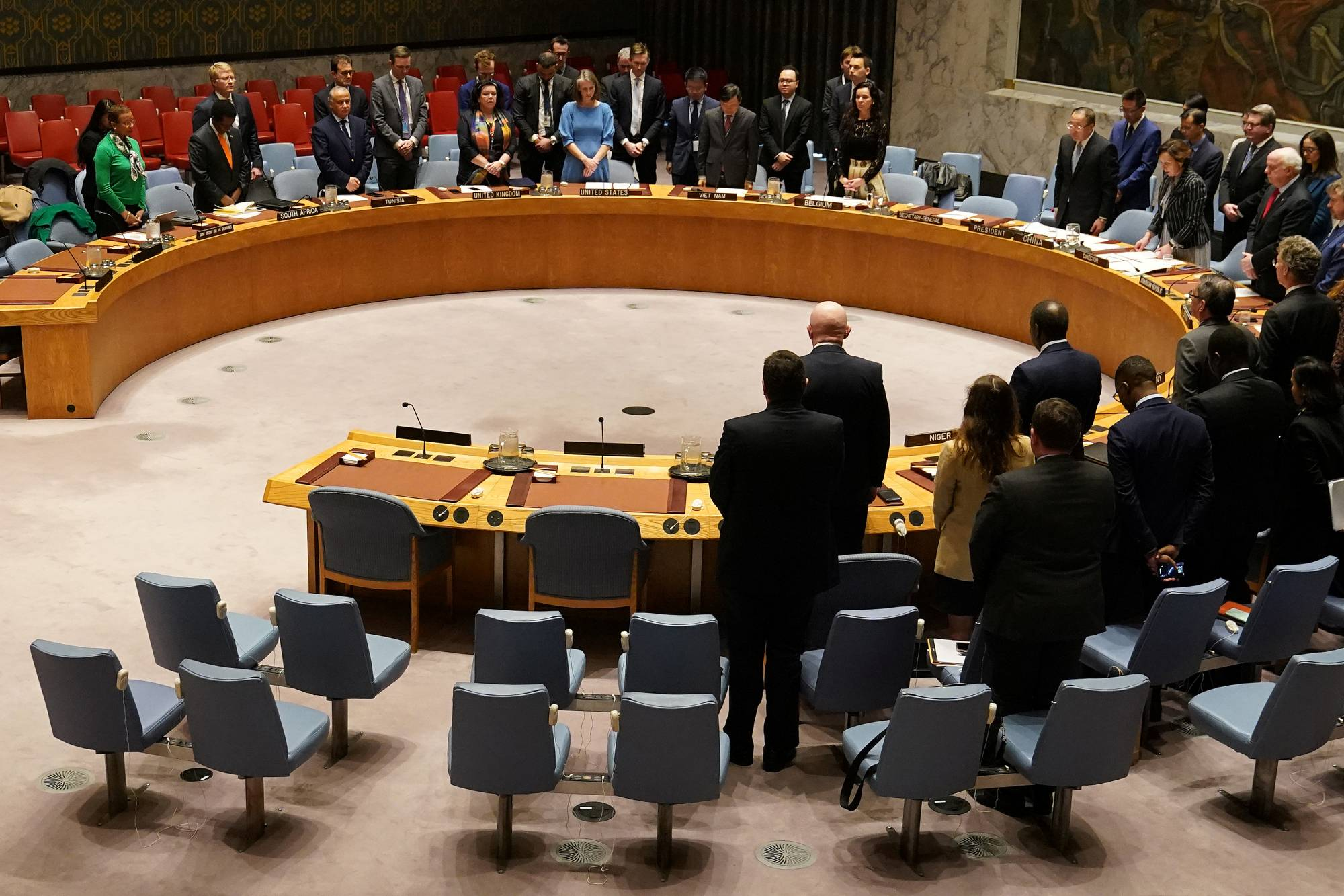 Members of the United Nations Security Council observe a moment of silence at the beginning of a meeting about Afghanistan at United Nations Headquarters in the Manhattan borough of New York City, New York, U.S., March 10, 2020. REUTERS/Carlo Allegri